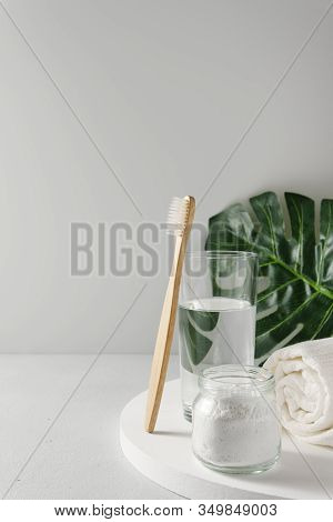 Bamboo Toothbrush, Glass Of Water, White A Cotton Towel And Powder For Brushing Your Teeth In Jar. L