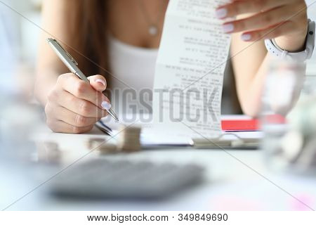 Thoughtful Home Budgeting And Tax Calculation. Close-up Beautiful Female Hands With Manicure Make Ca