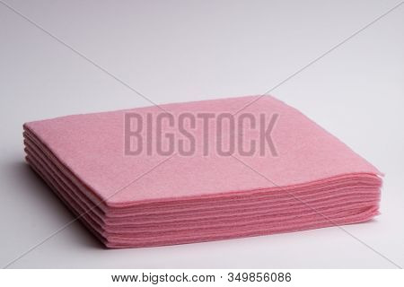 Pink Microfiber Cloths In A Stack On A White Background. Housewares.