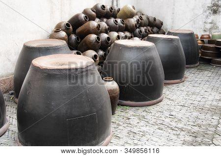 The Empty Xuchang Soy Sauce Clay Jars In Wuzhen Water Town In Zhejiang Province China.
