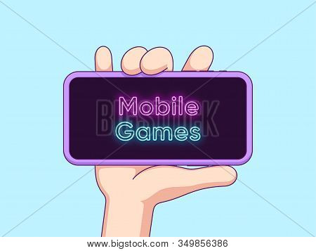 Cartoon Human Hand Keeps And Shows Touchscreen Phone With Neon Text Mobile Games On The Display. Pho
