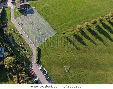 Aerial View Of Parkland Showing Tennis Courts In Evening Sunshine