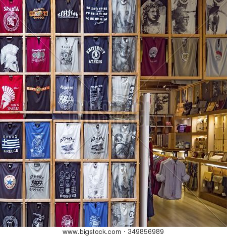 Athens, Greece - August 13, 2019: Greek Souvenir Shop With T-shirts And Other Clothing. National Sou