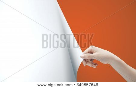 Woman Hand Turning Orange Page Of Blank White Paper. Occupation And Worker Concept.