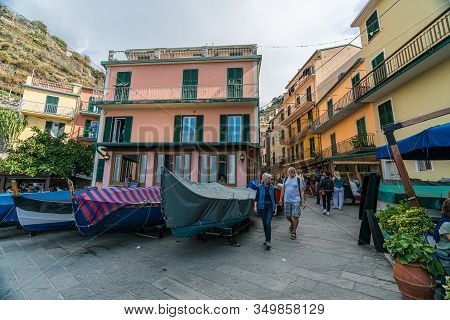 Manarola, Liguria, Italy - October 05 2017: Tourists Exploring The Historic Fisherman Village Of Man