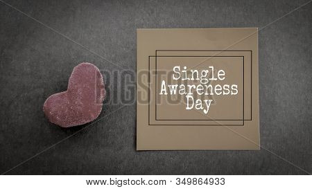 Inspirational Words Of Single Awareness Day Written On Notepaper In Vintage Background