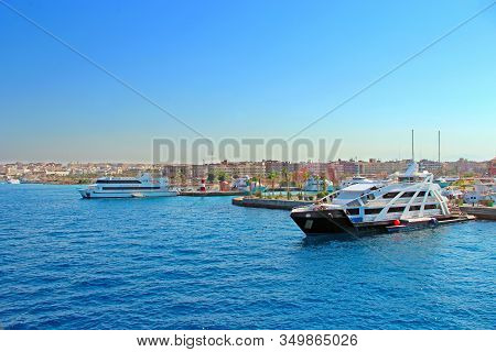 Hurghada / Egypt. 02 August 2018:city Harbor With Moored Boats Ships And Cruise Liners. Ships And Li
