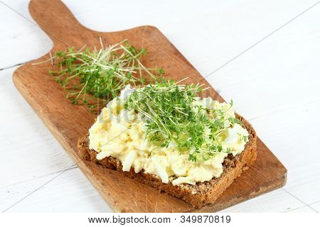 Egg Salad Over Brown Bread With Garden Cress. Homemade Spread Made From Eggs, Mayonnaise And Mustard
