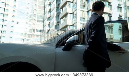 Bodyguard Opens Car Doors To Businesswoman, Provides Security For Vip Person