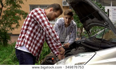 Father And Son Fixing Car, Dad Teaching Teen Boy To Repair Engine, Role Model
