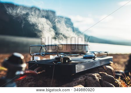Camping Cooking In Nature Outdoor, Prepare Breakfast Picnic In Mist Morning; Cooker Food Metal Gas S