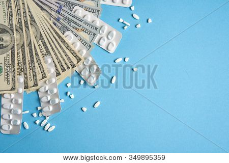 Pills Empty Blisters For Drugs Individual And Money Lie On A Blue Background Expensive Medicine Heal