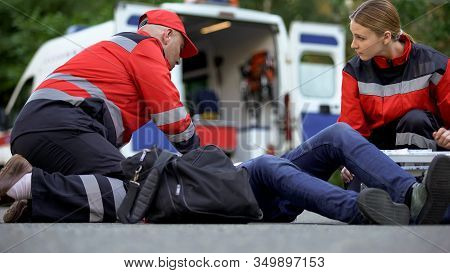 Paramedics Helping Patient On Road, First Aid Trainings, Medical Qualification