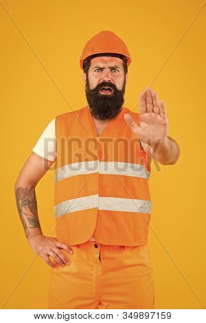 Stop. Dangerous Zone. No Entry. Man Engineer Protective Uniform Stop You. Architect Builder Engineer