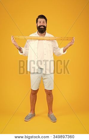 One Meter. Man Bearded Hipster Holding Ruler. Measure Length. Size Tall And Length. Big Size. Measur