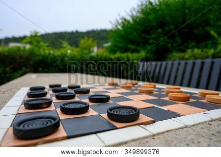 Low Angle Of Checkerboard From Black Side On Cement Table