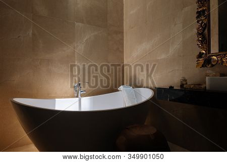 Stone Bath Tub In Luxury Interior Hotel With Sun Light From Top. Organic Spa Relaxation In Bali Bath