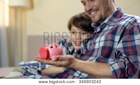 Dad And Son Holding Piggy-bank And Smiling, Social Welfare, Health Insurance