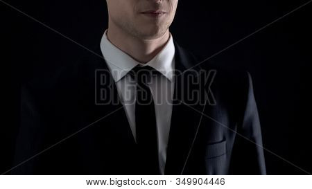 Man In Suit Smirking, Isolated On Black Background, Corruption And Bribery