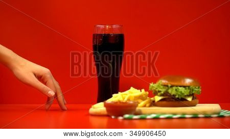 Tiny Woman Fingers Walking To Fast Food And Soft Drink, Tempted By Tasty Dish