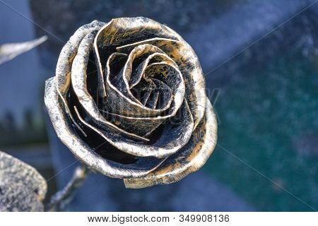 Old Metallic Rose Flower On Cemetery As Sign Of Memory. Iron Forge Rose Closeup