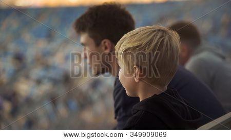 Little Boy With Older Brother On Football Stadium, Upbringing And Brotherhood