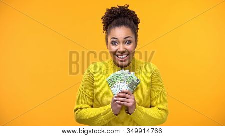 Glad African-american Woman Holding Bunch Of Euros, High-paying Job, Salary