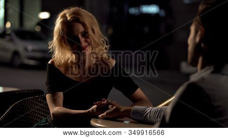 Happy Woman Holding Mans Hand, Sitting In Restaurant, Love Confession, Date