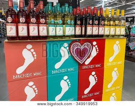 Orlando, Fl/usa-2/6/20: Cases Of Bottles Of Red, Pink And White Moscato And Pinot Grigio Barefoot Wi