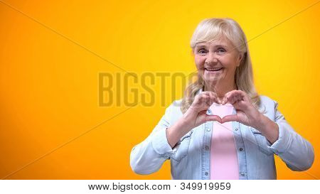 Happy Retiree Lady Showing Hand Heart Gesture, Love And Care, Valentines Day
