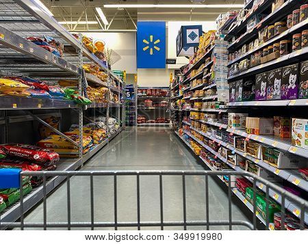 Orlando, Fl/usa-2/6/20:   The Dog Food Aisle From A Cart View At A Walmart Superstore Ready For Pet