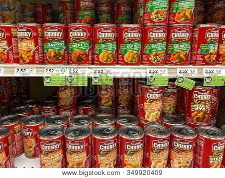 Orlando, Fl/usa-2/6/20: The Campbells Chunky Soup Aisle At A Publix Grocery Store With A Variety Of