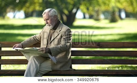 Elderly Gentlemen Reading News, Thinking About Political Situation, Outdoors