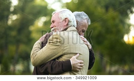 Mature Men Hugging, Happy To See Each Other, Old Friends Meeting, Greeting