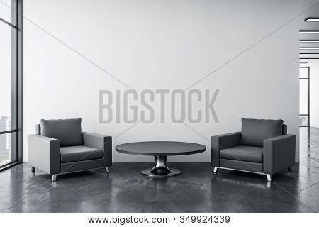 Cozy Waiting Room With Two Chairs, Table, Concrete Floor And Blank Wall. Workplace And Lifestyle Con