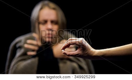 Hand Offering Ecstasy To Woman Suffering Withdrawal Symptoms, Drug Addiction