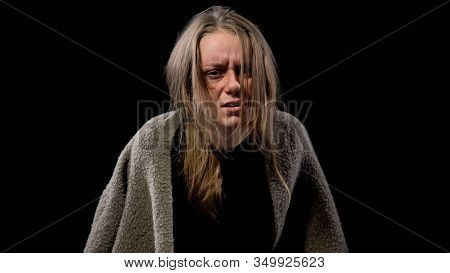 Desperate Young Woman With Wounds Face Covered With Dirty Blanket, Hopelessness