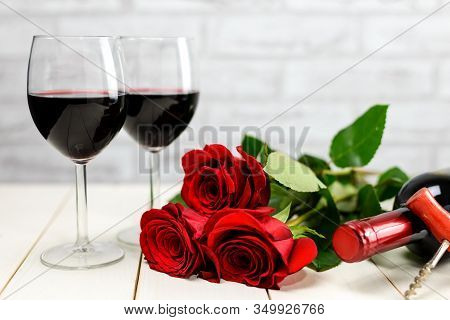 A Glasses Of Wine, Wine Bottle And Roses
