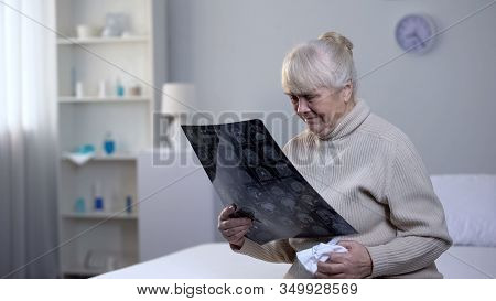 Crying Old Lady Looking At Brain X-ray In Hospital, Incurable Disease, Health