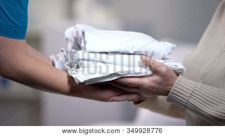 Chambermaid Giving Fresh Clean Bed-linen Elderly Female Client, Hotel Service