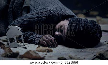 Pity Sick Refugee Sleeping On Street, Paper House Nearby, Seeking Asylum Concept