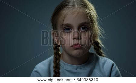 Melancholic Girl Looking At Camera, Piercing Glance, Child Hoping For Happiness