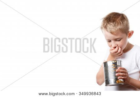 Little Child Is Looking In A Tin Can, Starving Boy Is Looking To Eat, Photo Is Isolated On A White B