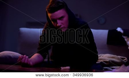 High Young Male Preparing To Make Drug Injection, Detrimental Habit Intoxication