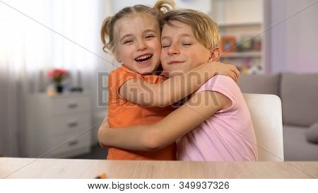 Happy Boy And Girl Hugging, Brother Sister Closeness, Tender Family Relations
