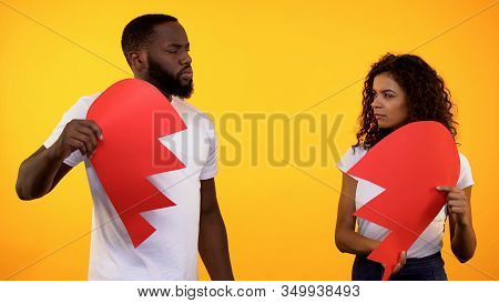 Angry Couple Holding Two Parts Of Paper Heart, Breakup Relationship, Crisis