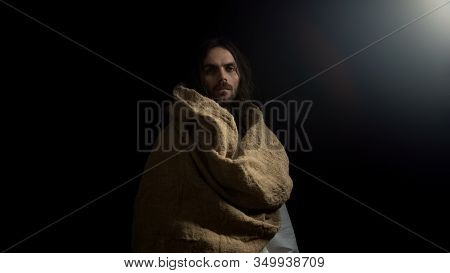 Male In Robe Standing In Darkness And Looking Into Camera, God Blessing, Gospel