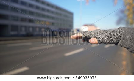 Man Catching Car, Cheap Way Of Travelling, Unsafe Journey Risk, Hand Close Up