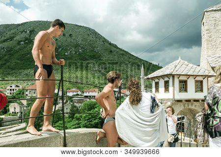 Mostar, Bosnia And Herzegovina - June 6, 2008: Senior Women, Tourists, Taking Pictures Of Men In Swi