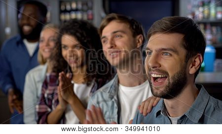 Cheerful Match Spectators Celebrating Goal, Supporting Team, Entertainment